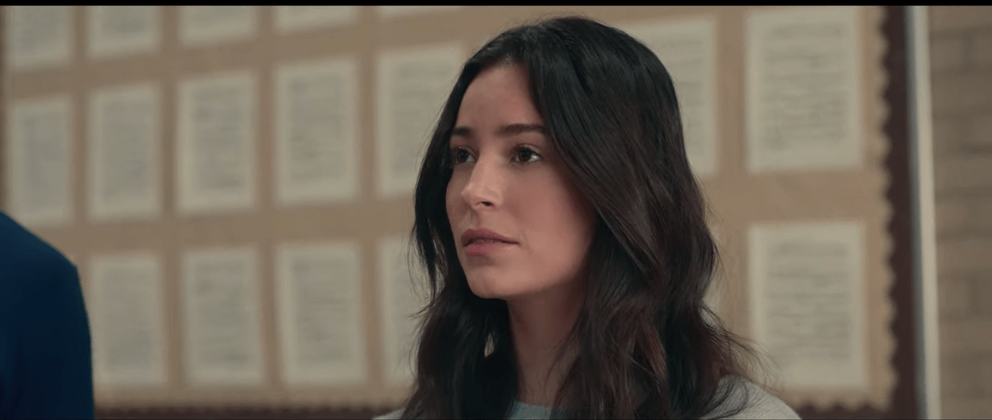 Picture of Aster Flores staring into the distance, her long, dark hair framing her face.