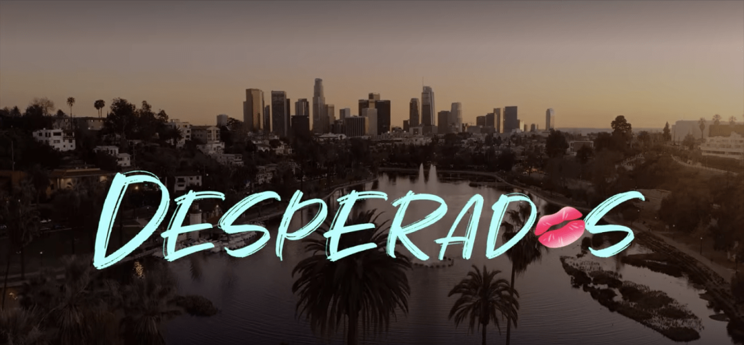 Los Angeles skyline with the title Desperados over it. The second letter O is a set of pink lips.