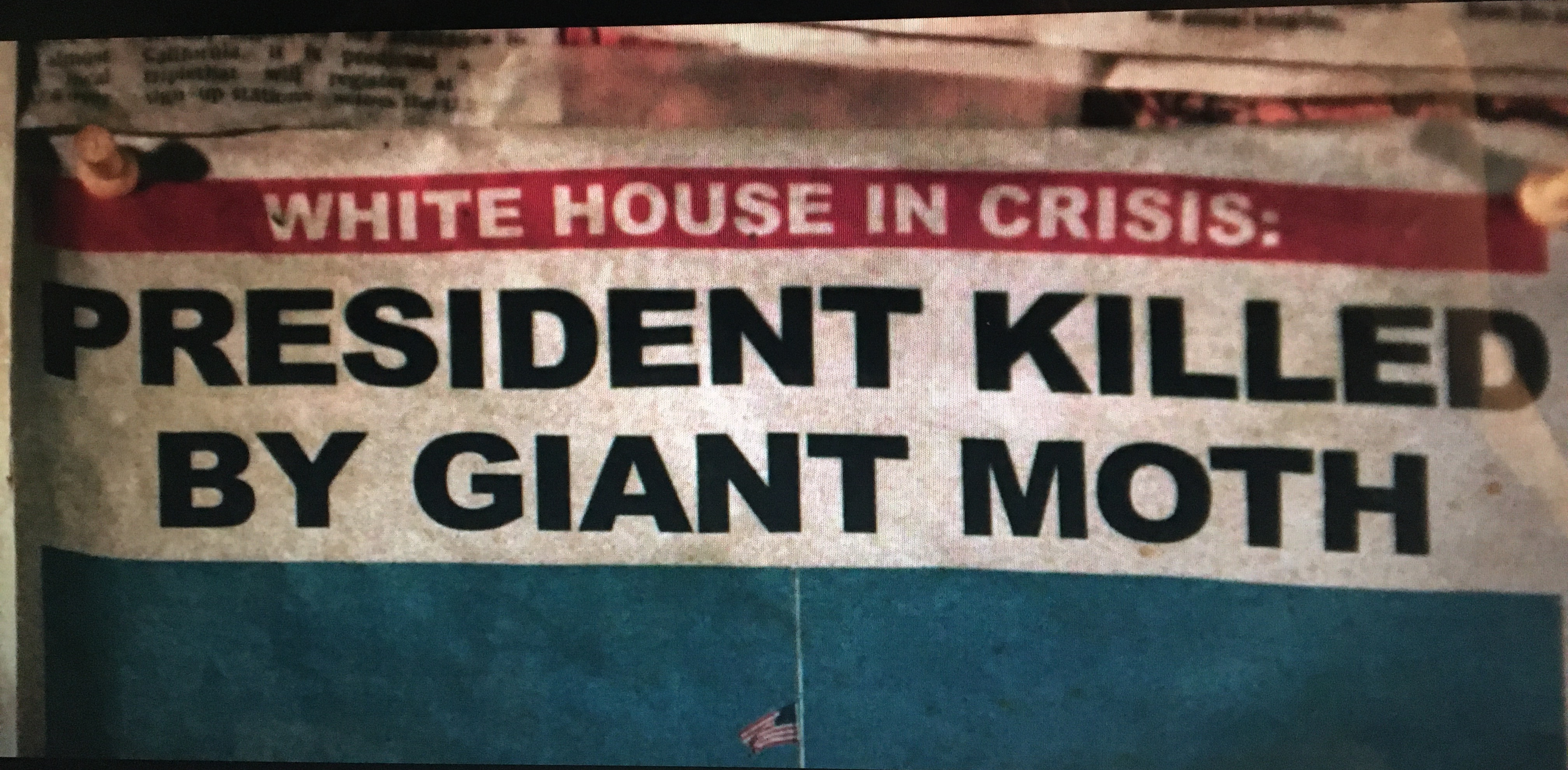 The top portion of a newspaper. the headline reads: White House in Crisis: President Killed by Giant Moth