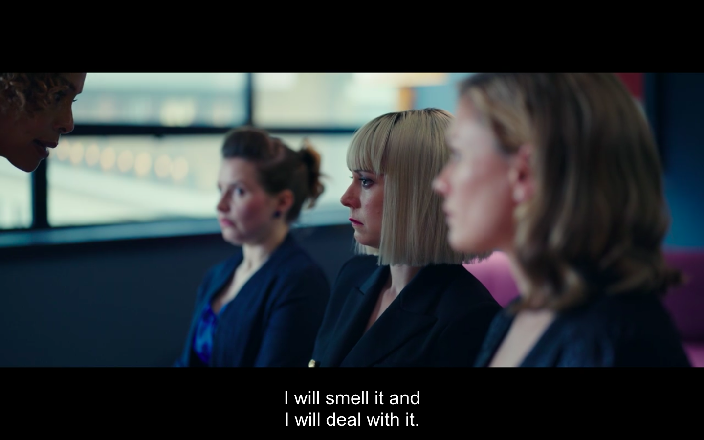 """Caroline's profile is just visible as she leans down to speak to Robyn, Eve, and Melody who sit miserably in front of her. The caption below says, """"I will smell it and I will deal with it."""" A reference to her being like a polar bear."""