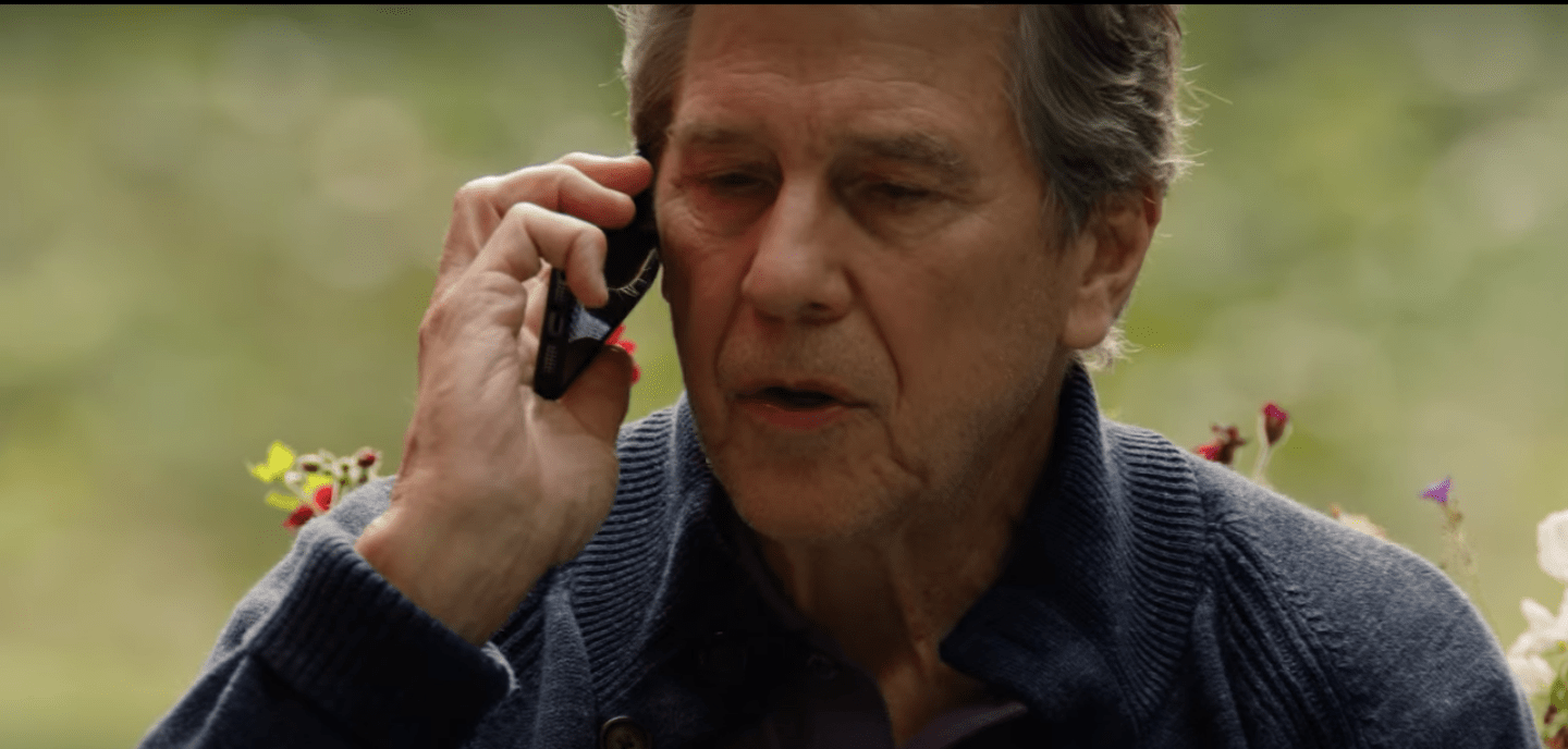 Close up of Doc on the phone trying to get ahold of Hope