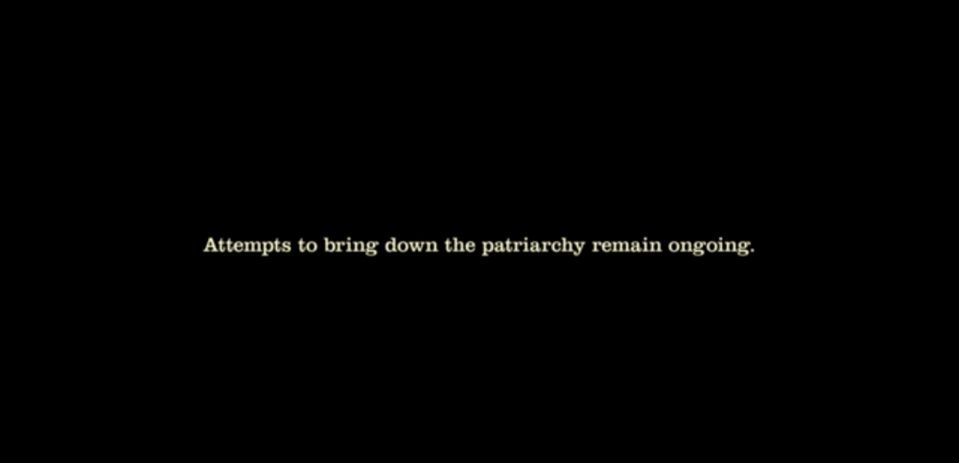 """White text on a black background that reads: """"Attempts to bring down the patriarchy remain ongoing."""""""