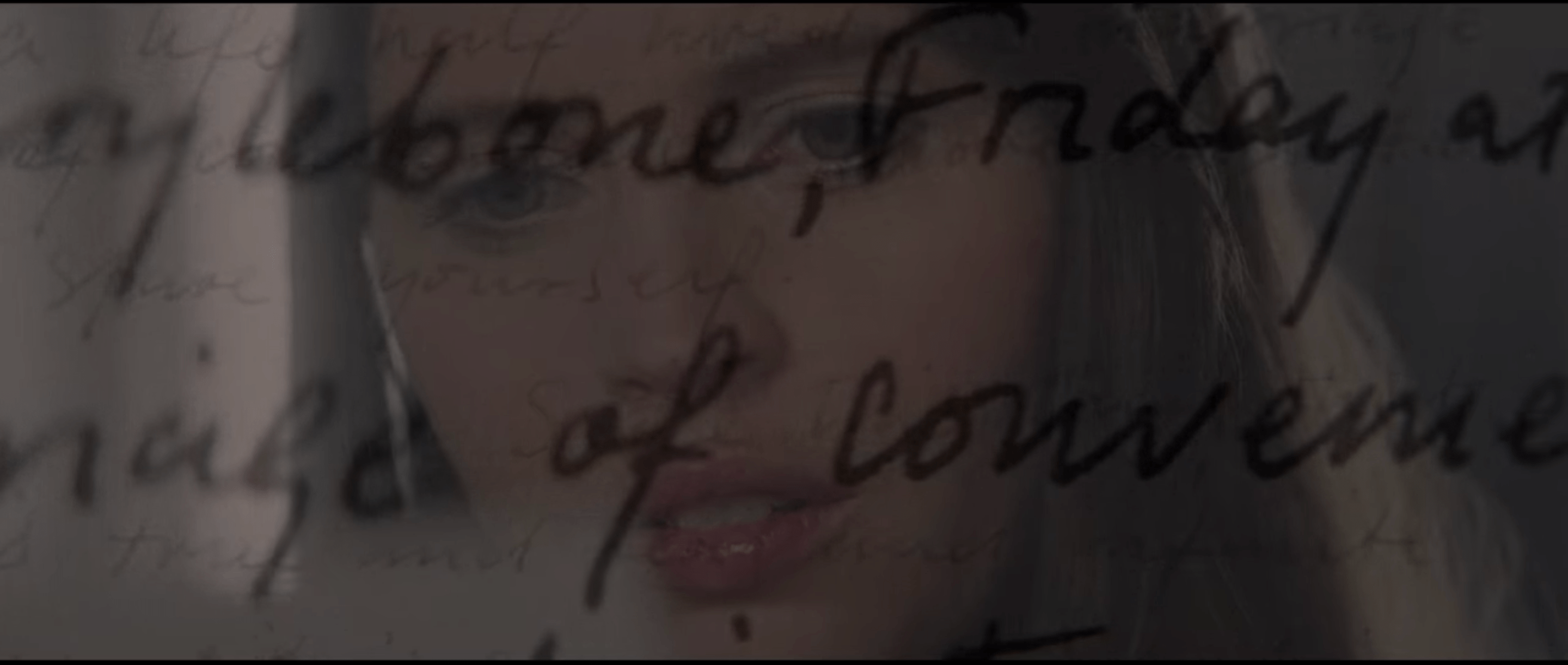 Ellie's face with handwriting from one of the of love letters superimposed over her face.